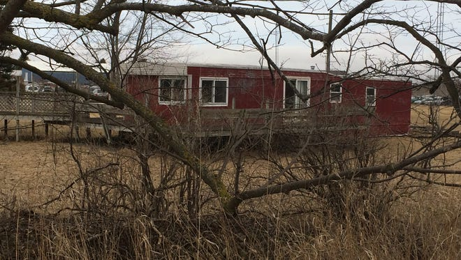 A view of Steven Avery's trailer from the far backyard of his property.