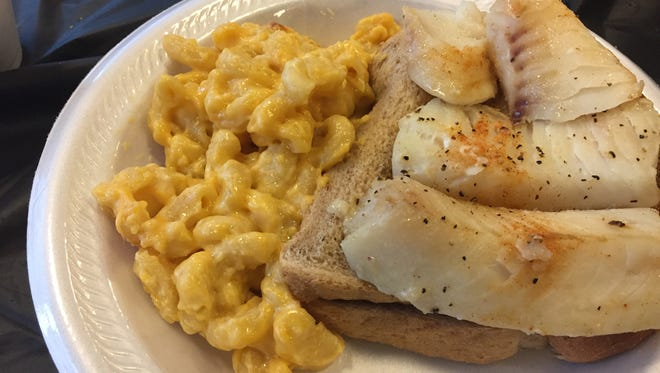 The baked cod and macaroni and cheese dinner at The St. Francis de Sales fish fry in Walnut Hills