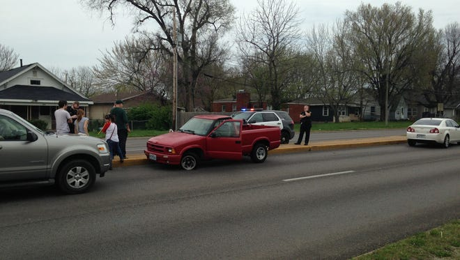 Police investigate a stolen truck Sunday afternoon on Kansas Expressway in Springfield.