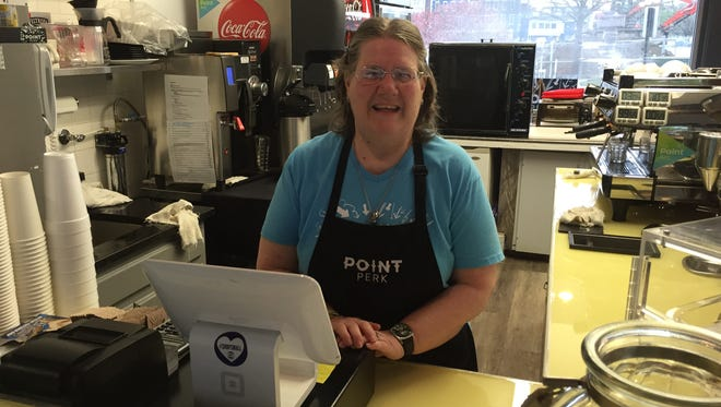 Mary Ellen Cann operates the cash register at Point Perk.