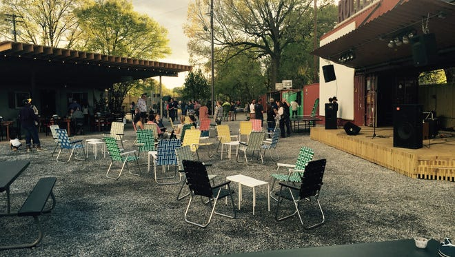 The rear courtyard at Railgarten (2166 Central Ave.), flanked by stage, tiki bar and Ping-Pong tables