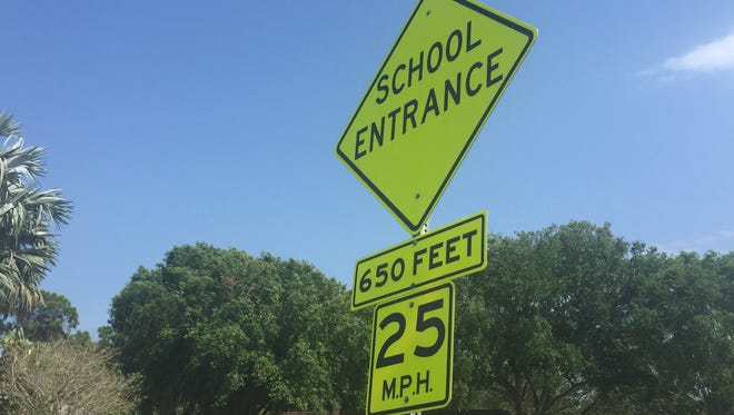 The school zone sign outside Odyssey Charter Elementary School on Eldron Boulevard. There are no flashing lights, and the lowest speed limit on the road is 25 mph. Over at Jupiter Elementary, about 15 minutes away, there are signs with flashing lights and the lowest speed limit is 15 mph.