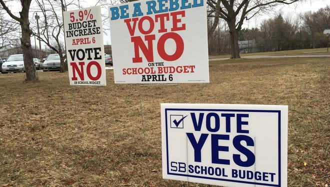 Signage posted on Thursday, April 6, 2017, in front of Orchard Elementary School in South Burlington. The community was voting on the school budget following defeat of their budget on Town Meeting Day.