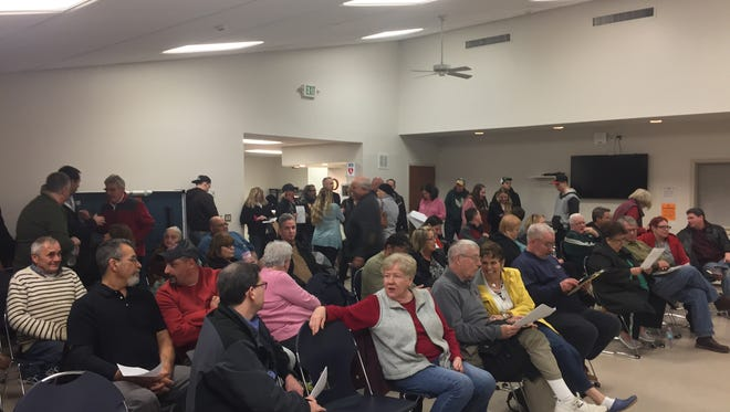 Residents gather at the Robert D. Wilson Memorial Community Center minutes before a vote was scheduled to reject a sea wall plan offered by the Army Corps of Engineers.