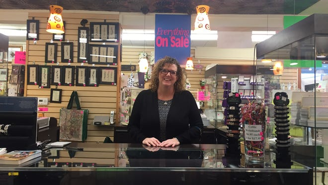 Frances Siefert, owner of Ballyhugh Irish Imports in Audubon, works in the store her mother and father opened in 1983.