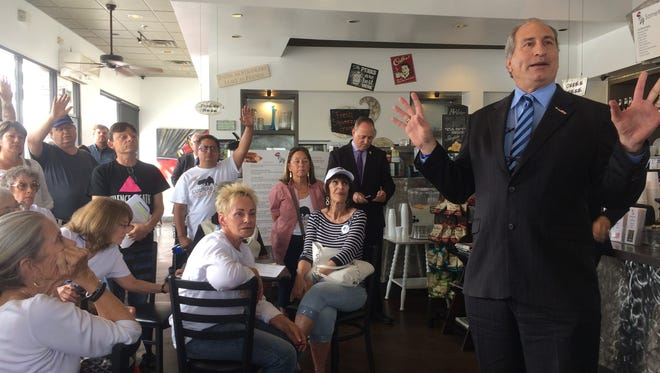 """Progressive activists confronted Republican state Sen. Jeff Stone in Indio on April 6, 2017, over statements he'd made in opposition to making California a """"sanctuary state."""""""