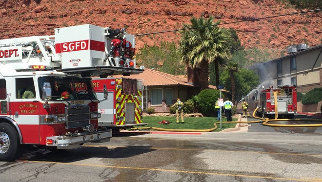 St. George Fire Department personnel respond to a Saturday afternoon condo fire that left four homes' residents termporarily out of doors.