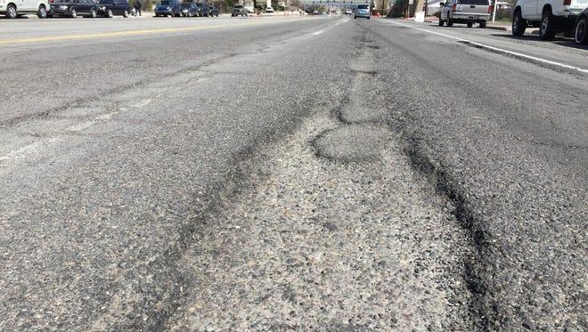 A photo of potholes along 2nd Street in Reno.