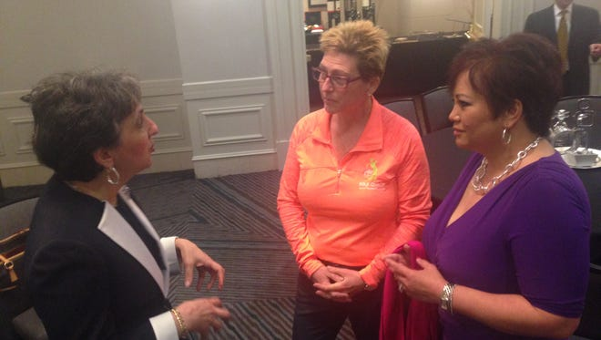 Garfield couple Christine Cipriano, center, and Ferlie Almonte, right, discuss entrepreneurship with a New Jersey LGBT Chamber of Commerce member.