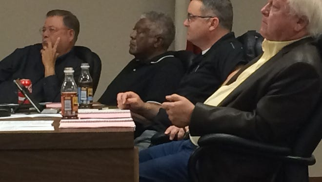 School board members Bill Franklin, Tom Bursey, Adam Groves and Mike Rucker listen to an update on the district's improvement-required schools at an April 11 special session.