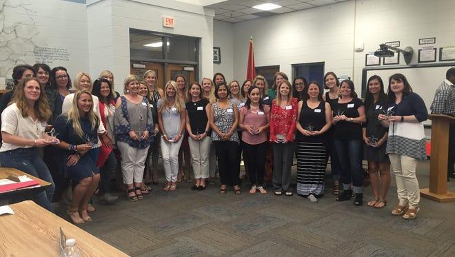 Franklin Special School District's top volunteers display their awards.