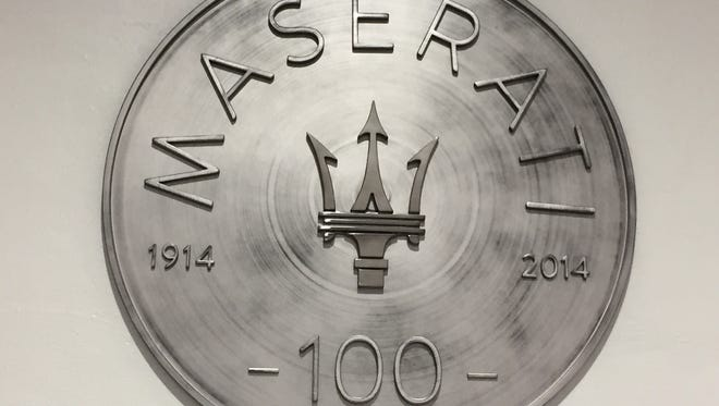 A commemorative plate celebrating 100 years of Maserati heritage at the company's Grugliasco Plant in Turin, Italy.