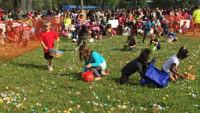 Children collect Easter eggs Saturday at Astoria Elementary School. There were 14,000 eggs divided up by age groups for children to find.