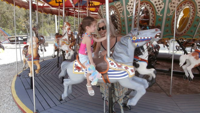 A carousel obtained last year from an amusement park in Panama City is a hit at Mike Greenwell's Bat-A-Ball & Family Fun Park.