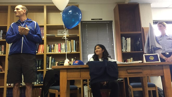 Blanchet Catholic track and field coach David Mucken (left) talks during the signing ceremony for senior Leilani Salang on Wednesday, April 19, 2017.