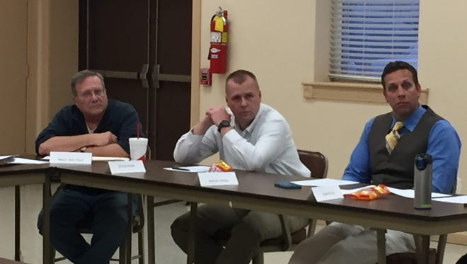 Joshua Corney, right, listens during a Glen Rock council meeting Wednesday. Christopher Dornblaser photo.