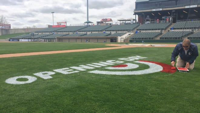 Head groundskeeper Dan Purner putting the finishing touches on the Opening Day logo at the Somerset Patriots' TD Bank Ballpark in Bridgewater.