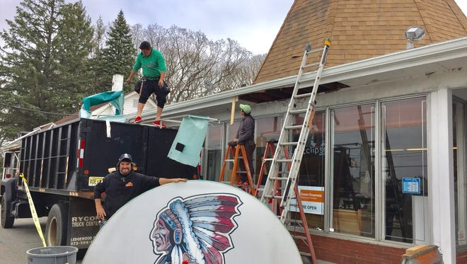 John Samurai of Samurai Contracting in Allamuchy with one of the Native Americn symbols he has removed form the old Cherokee Trading Post building on route 46 in the Budd Lake section of Mount Olive.