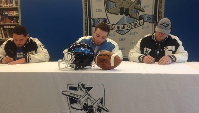 Enka seniors Aaron Norton, Garrett Banks and Joe Brown have signed to play college football.