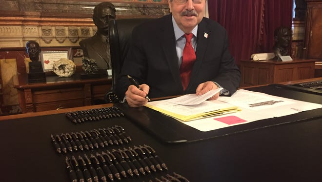 Gov. Terry Branstad had dozens of pens on his desk as he signed bills passed by the Iowa Legislature on April 20, 2017. Branstad gives out the pens after bill signing ceremonies to people who have been personally involved in the legislation. He said he uses many pens in signing his name, switching pens many times as he writes.