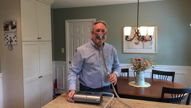 David Bonk, a Hockessin resident and sleep apnea patient, demonstrates his CPAP machine.