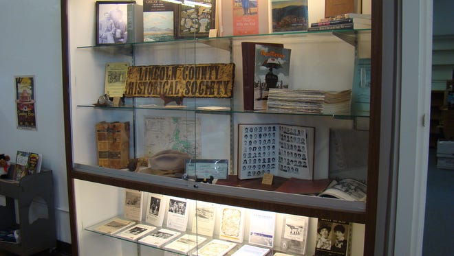 """The new library, Carrizozo Public Library & Archive, located on Central Avenue, is also headquarters for Lincoln County Historical Society. This display case was on hand for the event, """"Carrizozo Celebrates Your History on April 22."""""""