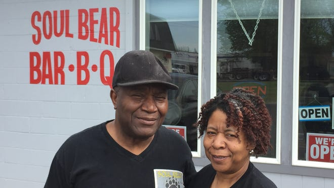 Soul Bear Bar-B-Que owners Samuel and Pamela Hodges in front of the restaurant they opened in March on Crawfordsville Road in Clermont.