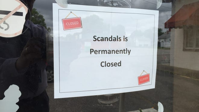 Sign posted on the door of Scandals, a nightclub that was cited by state excise police last weekend.
