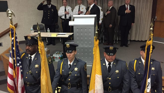 A color guard stands at attention during the Pledge of Allegiance at the opening of a two-day seminar on gang violence at the Morris County Police and Fire Safety Academy in Parsippany on April 26, 2017. At the podium is Morris County Sheriff's Office gang expert Cpl. Edwin Santana.