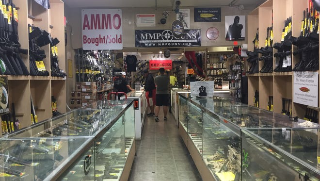 Firearms section at Mo Money Pawn Shop near 12th Street and Indian School Road.