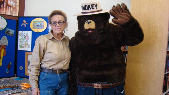 "Bennie Long, manager at Smokey Bear Historical Park and Smokey Bear greeted visitors during the opening of Carrizozo Community Public Library and Archives. During the April 22 event, ""Carrizozo Celebrates Your History,"" Long and Smokey shared a display of fire prevention information."
