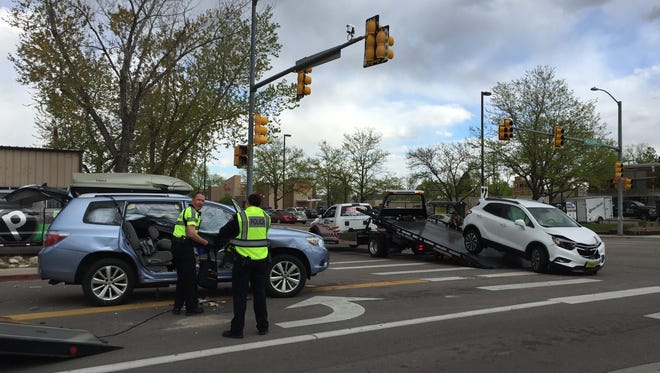 A two-car crash left one car on its roof at Horsetooth Road and Mason Street on Monday.