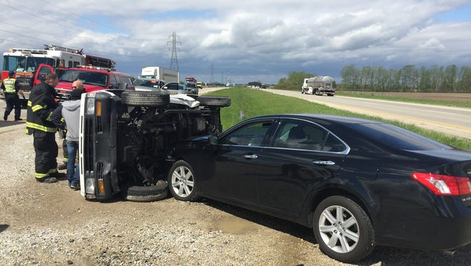 Three people were injured Monday in a two-vehicle accident on the Muncie Bypass east of Cowan Road.