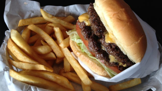 May is National Hamburger Month. Here, a Wolf Pack Burger from Archie's Giant Hamburgers (formerly Archie's Famous Grill) in Reno.