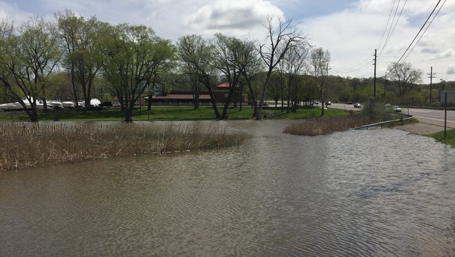This parking area off Empire Boulevard is submerged by the rising waters of Irondequoit Bay.