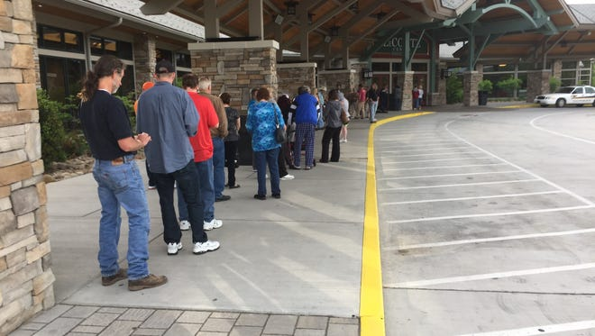 People at the LeConte Center in Pigeon Forge line up to receive their final Dollywood Foundation checks.