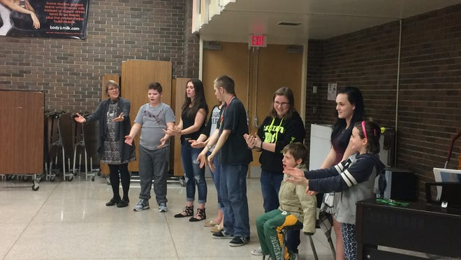 T.J. Walker Middle School music teacher Leslie Hill (left) and students Drini Ismaili, Maddie Blahnik, Sydney Felhofer, Soren Anderson, Emma McDonald, Ethan Sallinen, Jadacey Stahl, and Mia Hartl perform during the Celebrate Autism event at Sturgeon Bay School District in April.