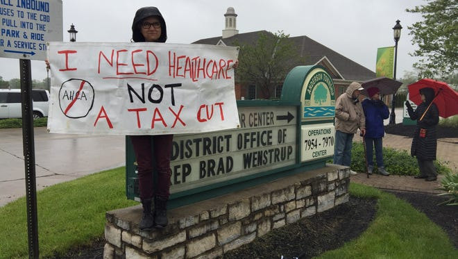 Anderson Township resident Claudia Cline joined several dozen other demonstrators in front of Rep. Brad Wenstrup's office on May 5.