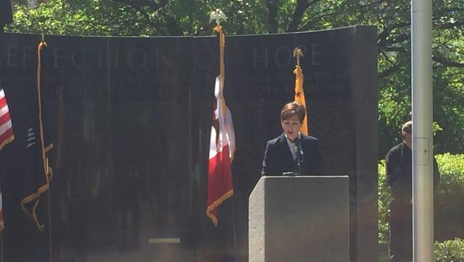 Iowa Lt. Gov. Kim Reynolds speaks during the Iowa Vietnam Wall Dedication for Jim McGough.