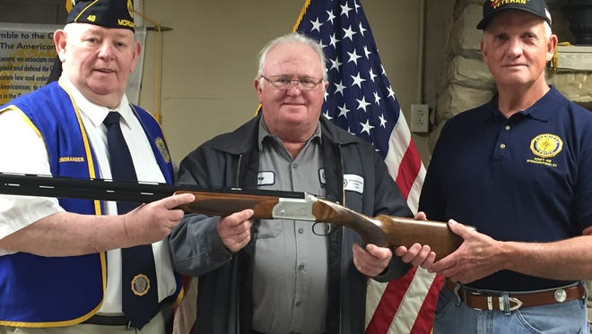 Above are Griggs-Alvey American Legion Post # 48 Commander George Blakeley  and Finance Officer Dickie Berry presenting a shotgun to Gary Kramer. The shotgun was donated by Legion member Harvey Messer for a fund raiser for Post # 48.