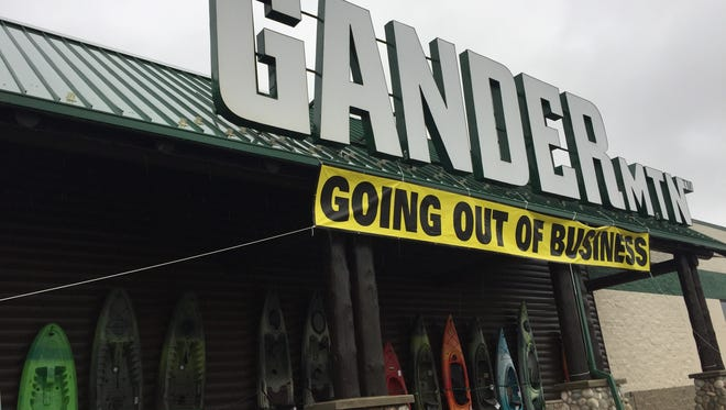 "A ""Going Out of Business"" sign hangs outside the Gander Mountain location in Salisbury on Friday, May 5."