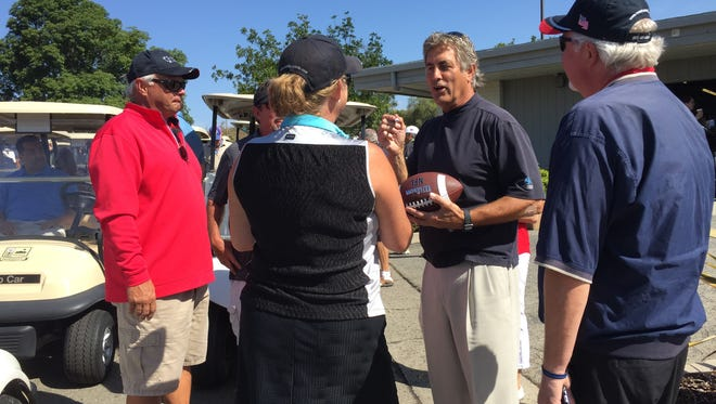 Former Los Angeles Rams quarterback Vince Ferragamo signs an autograph for a golfer at the 2017 Big Brothers Big Sisters Golf Tournament. Ferragamo is back as the celebrity host for this year's tournament.