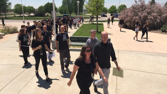 """Fossil Ridge High School staff members marched around the school Friday, May 12. The group told the Coloradoan they were marching for unity and positive school culture """"in these times of uncertainty."""""""