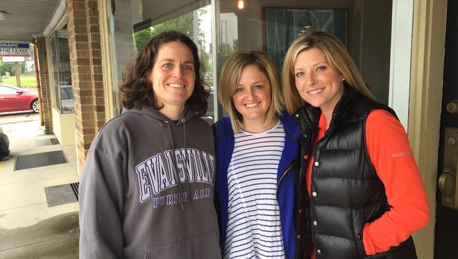 Former University of Evansville softball players Kate Walker, Emily Hays and Natalie Hedde (left to right) have teamed up again, this time on an effort to raise money for a shelter for sexual abuse victims in Haiti.