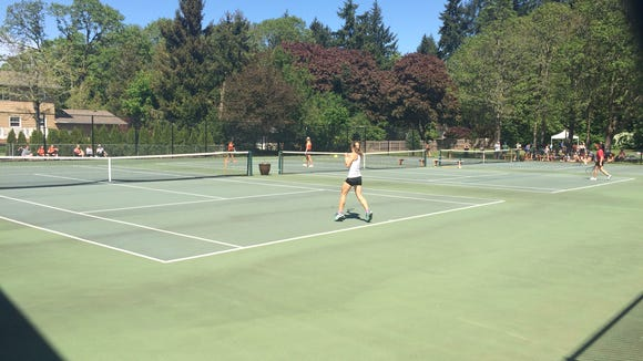 Players compete at the Greater Valley Conference district tennis tournament at Salem Tennis and Swim Club.