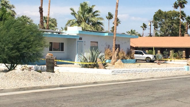Security tape surrounds a Palm Springs home where a man was found dead May 16. His death is being investigated as a homicide and a suspect was arrested hours later following a pursuit.