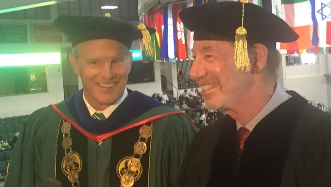 Tony Kornheiser, right, and Binghamton University President Harvey Stenger share a laugh during a media conference Friday at BU's Events Center. Kornheiser, co-host of ESPN's Pardon the Interruption, received an honorary degree Friday.