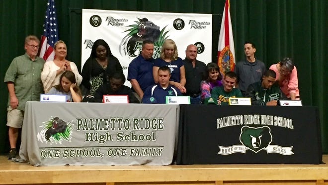 Five Palmetto Ridge student-athletes announced their commitments to colleges during a signing ceremony at the school Friday. Seated from left to right are Monet Burkett, Jerome Cunningham, Ken Geiger, Wayne Walter and Jon Woo.