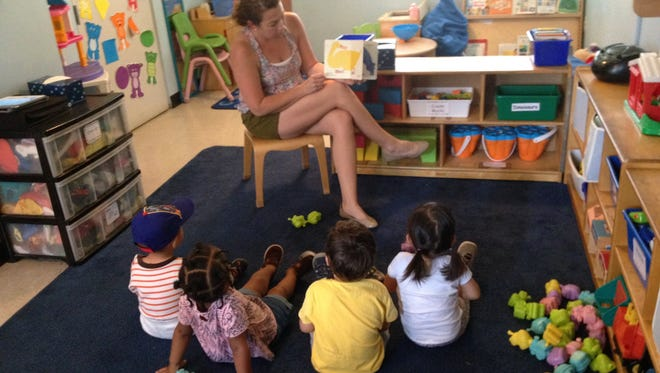 Suzanne Cloud reads to group at FSU's Infant and Toddler Child Development Center. The center is moving from Alumni Village to a new downtown location in August.