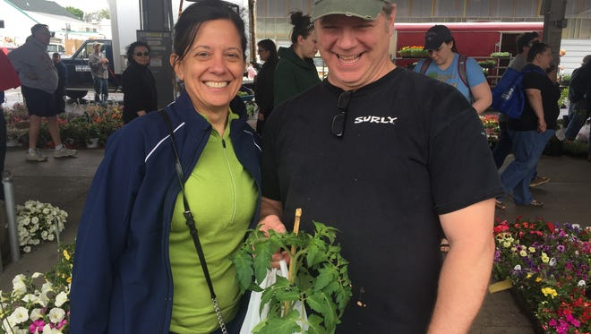 Kim and Scott Page of Pittsford shopping for vegetables and flowers at the Rochester Public Market.